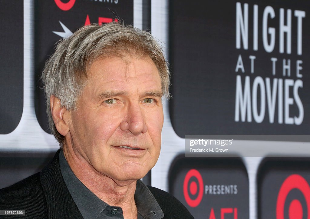 Actor <a gi-track='captionPersonalityLinkClicked' href=/galleries/search?phrase=Harrison+Ford+-+Sk%C3%A5despelare+-+F%C3%B6dd+1942&family=editorial&specificpeople=11508906 ng-click='$event.stopPropagation()'>Harrison Ford</a> arrives on the red carpet for Target Presents AFI's Night at the Movies at ArcLight Cinemas on April 24, 2013 in Hollywood, California.