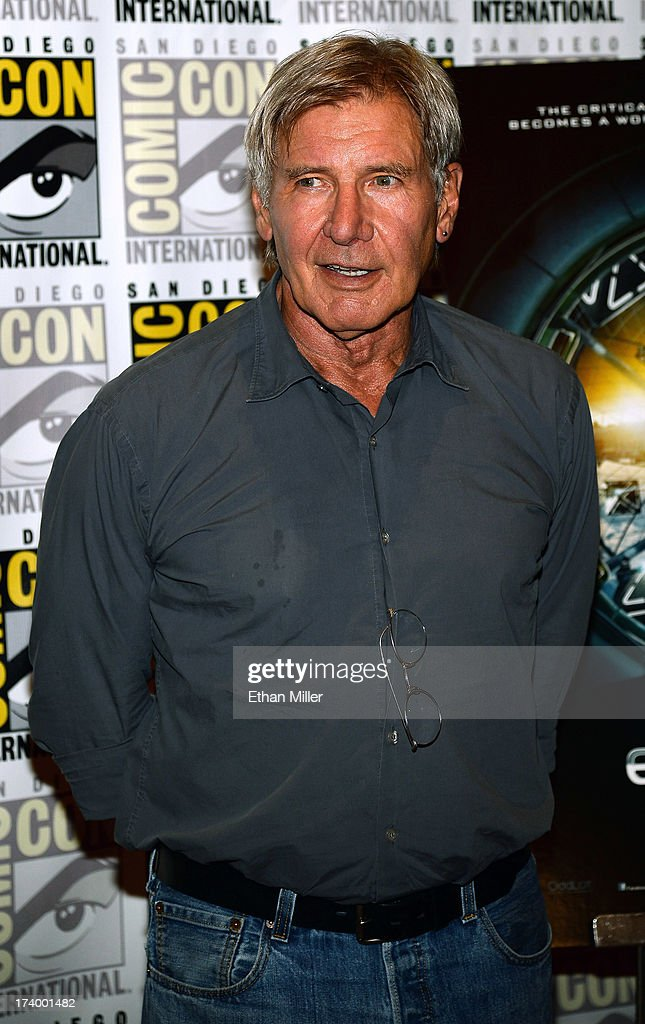 Actor <a gi-track='captionPersonalityLinkClicked' href=/galleries/search?phrase=Harrison+Ford+-+Actor+-+Born+1942&family=editorial&specificpeople=11508906 ng-click='$event.stopPropagation()'>Harrison Ford</a> attends the 'Ender's Game' and 'Divergent' press line during Comic-Con International 2013 at the Hilton San Diego Bayfront Hotel on July 18, 2013 in San Diego, California.