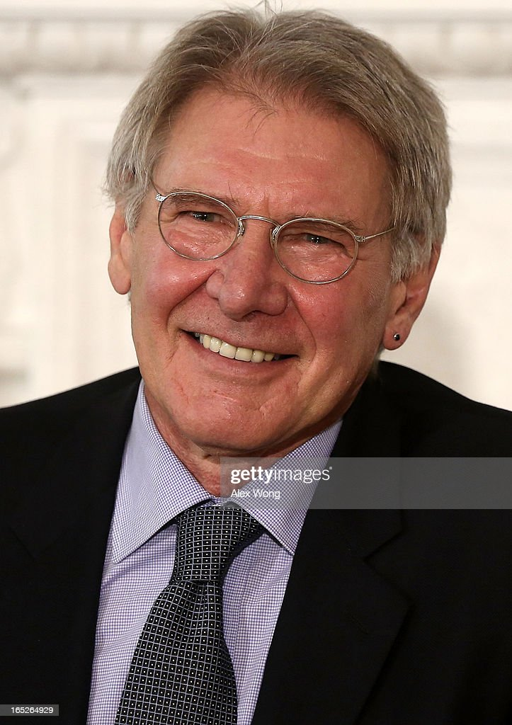 Actor <a gi-track='captionPersonalityLinkClicked' href=/galleries/search?phrase=Harrison+Ford+-+Actor+-+Born+1942&family=editorial&specificpeople=11508906 ng-click='$event.stopPropagation()'>Harrison Ford</a> listens during a State Dining Room event April 2, 2013 at the White House in Washington, DC. U.S. first lady Michelle Obama made remarks during an interactive student workshop with the cast and crew of the movie '42,' a biographical film about Jackie Robinson, the first African American player in Major League Baseball.