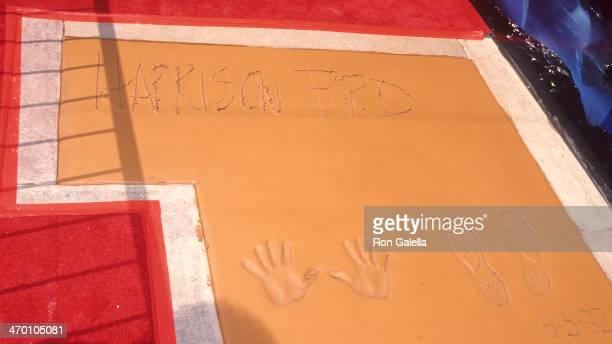 Actor Harrison Ford places his footprints and handprints in cement at the forecourt of the Mann's Chinese Theatre on June 3 1992 at the Mann's...