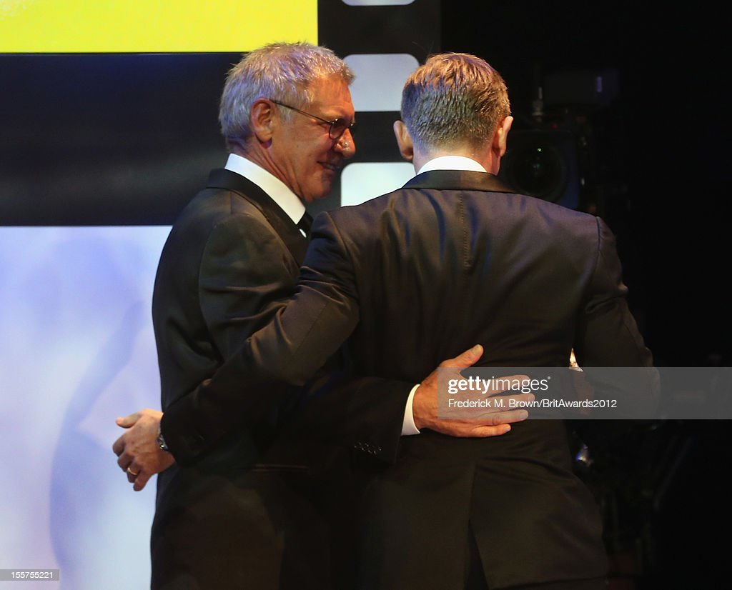 Actor Harrison Ford presents honoree Daniel Craig with the Britannia Award for British Artist of the Year onstage at the 2012 BAFTA Los Angeles Britannia Awards Presented By BBC AMERICA at The Beverly Hilton Hotel on November 7, 2012 in Beverly Hills, California.