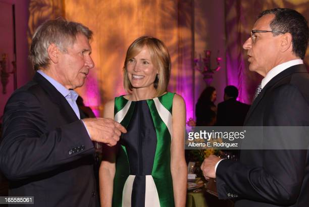 Actor Harrison Ford Senior Editor of The Huffington Post Willow Bay and Chairman and CEO of The Walt Disney Company Bob Iger attend Conservation...