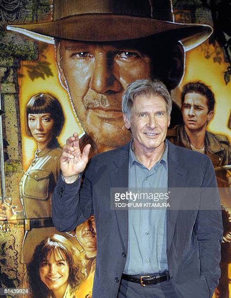 US actor Harrison Ford smiles upon his arrival at his latest movie premiere in Japan 'Indiana Jones and the kingdom of the crystal skull' in Tokyo on...