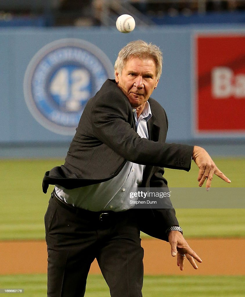 Actor <a gi-track='captionPersonalityLinkClicked' href=/galleries/search?phrase=Harrison+Ford+-+Actor+-+Born+1942&family=editorial&specificpeople=11508906 ng-click='$event.stopPropagation()'>Harrison Ford</a>, who plays Branch Rickey in the Jackie Robinson biography movie 42, throws out the first pitch before the game between the San Diego Padres and the Los Angeles Dodgers at Dodger Stadium on April 15, 2013 in Los Angeles, California. All uniformed team members are wearing jersey number 42 in honor of Jackie Robinson Day.