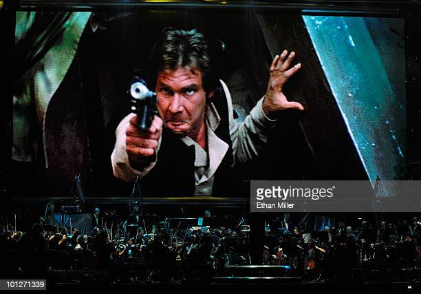 Actor Harrison Ford's Han Solo character from 'Star Wars Episode VI Return of the Jedi' is shown on screen while musicians perform during 'Star Wars...