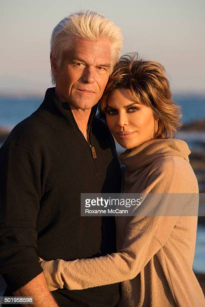 Actor Harry Hamlin and actress and tv personality Lisa Rinna pose for a photo at sunset on the beach November 29 2015 in Malibu Lisa Rinna is...