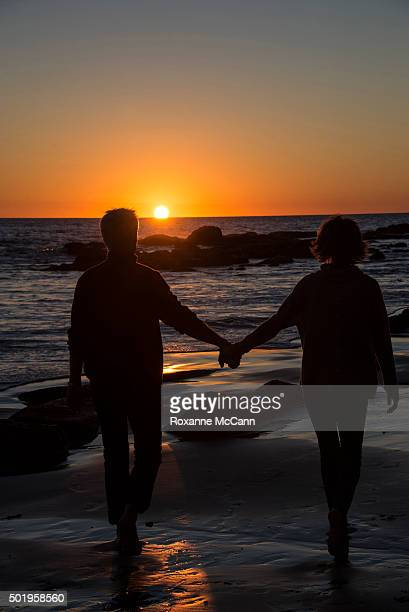 Actor Harry Hamlin and actress and tv personality Lisa Rinna walk at sunset on the beach at sunset November 29 2015 in Malibu Lisa Rinna is currently...