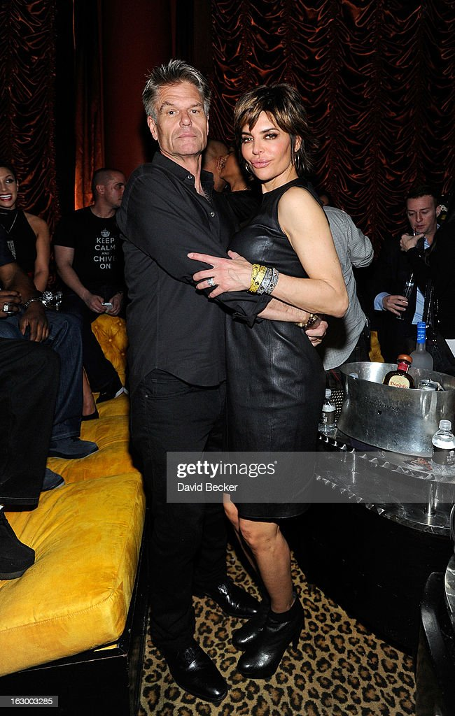 Actor Harry Hamlin (L) and actress Lisa Rinna appear at the Surrender Nightclub at Encore Las Vegas in celebration of the season premiere of 'All-Star Celebrity Apprentice' on March 2, 2013 in Las Vegas, Nevada.