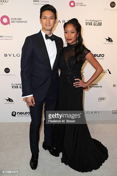 Actor Harry Shum Jr and actress Shelby Rabara attends the 24th Annual Elton John AIDS Foundation's Oscar Viewing Party on February 28 2016 in West...
