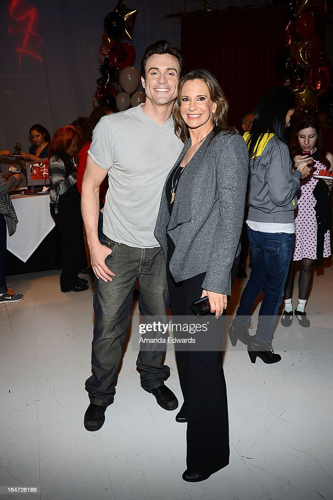 Actor Hartley Sawyer (L) and actress <a gi-track='captionPersonalityLinkClicked' href=/galleries/search?phrase=Jess+Walton&family=editorial&specificpeople=243212 ng-click='$event.stopPropagation()'>Jess Walton</a> attend the 'The Young & The Restless' 40th anniversary cake-cutting ceremony at CBS Television City on March 26, 2013 in Los Angeles, California.