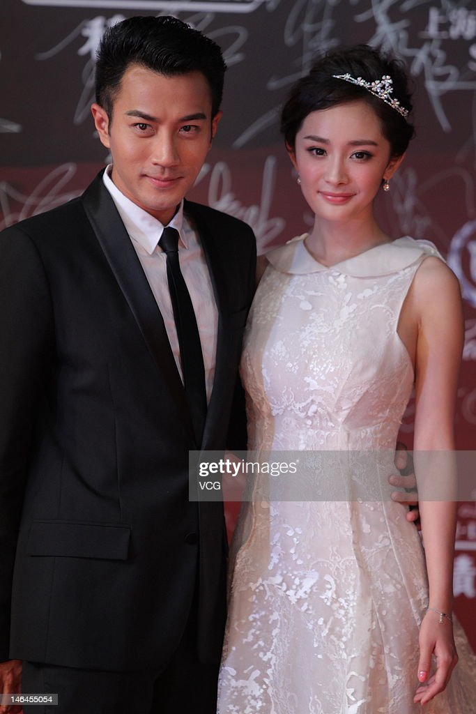Actor Hawick Lau and actress Yang Mi arrive at the red carpet during the opening ceremony for the 15th Shanghai International Film Festival at...