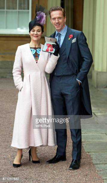 Actor Helen McCrory with husband Damian Lewis pose after she was awarded an OBE by Queen Elizabeth II at an Investiture ceremony at Buckingham Palace...