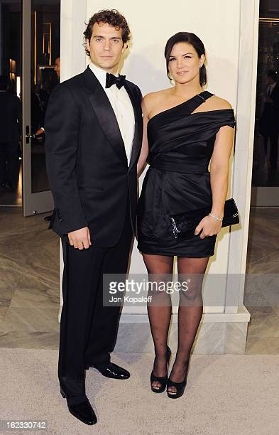 Actor Henry Cavill and actress Gina Carano arrive at Tom Ford Cocktails In Support Of Project Angel Food Media at TOM FORD on February 21 2013 in...