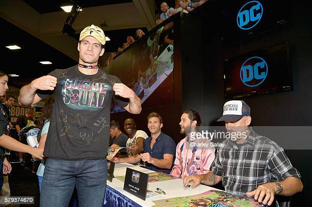 Actor Henry Cavill gets his tshirt signed by actors Adewale AkinnuoyeAgbaje Jared Leto and director David Ayer from the cast of Suicide Squad film in...