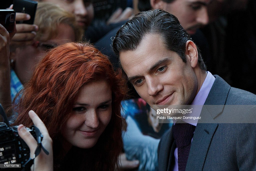 Actor <a gi-track='captionPersonalityLinkClicked' href=/galleries/search?phrase=Henry+Cavill&family=editorial&specificpeople=3767741 ng-click='$event.stopPropagation()'>Henry Cavill</a> stands with fans during the 'Man of Steel' (El Hombre de Acero) premiere at the Capitol cinema on June 17, 2013 in Madrid, Spain.