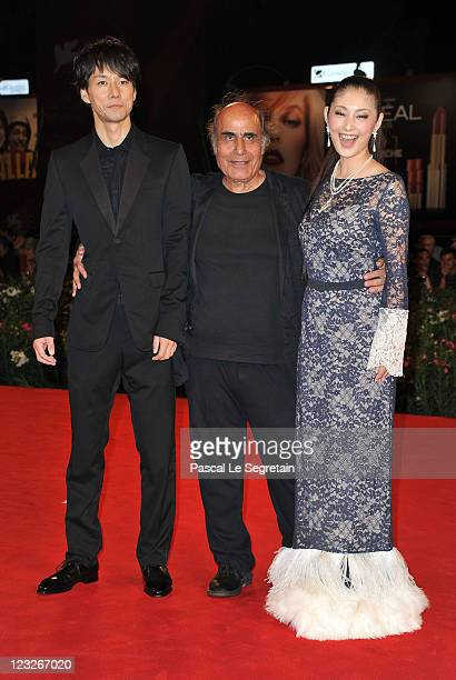 Actor Hidetoshi Nishijima director/writer Amir Naderi and actress Takako Tokiwa attends the 'Cut' premiere at the Palazzo Del Cinema during the 68th...