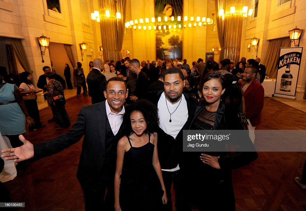 Actor Hill Harper actress Troi Zee director Tommy Oliver and actress Sharon Leal attend the '1982' Reception during the 2013 Toronto International...