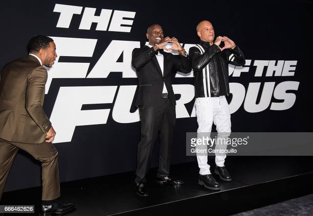 Actor/ hip hop recording artist Ludacris actor/ singersongwriter Tyrese Gibson and actor Vin Diesel attend 'The Fate Of The Furious' New York...