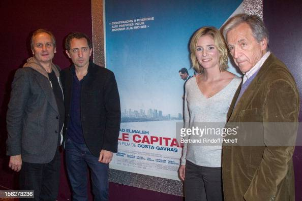 Actor Hippolyte Girardot actor Gad Elmaleh actress Natacha Regnier and filmmaker CostaGavras pose as they attend 'Le Capital' premiere at Gaumont...