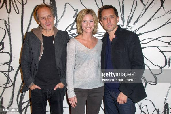 Actor Hippolyte Girardot actress Natacha Regnier and actor Gad Elmaleh pose as they attend 'Le Capital' premiere at Gaumont Parnasse on November 12...