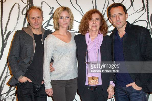 Actor Hippolyte Girardot actress Natacha Regnier producer Michele RayGavras and actor Gad Elmaleh pose as they attend 'Le Capital' premiere at...