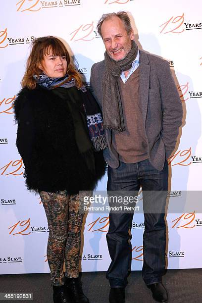 Actor Hippolyte Girardot and his wife attend the '12 Years a Slave' movie Premiere at Cinema UGC Normandie on December 11 2013 in Paris France