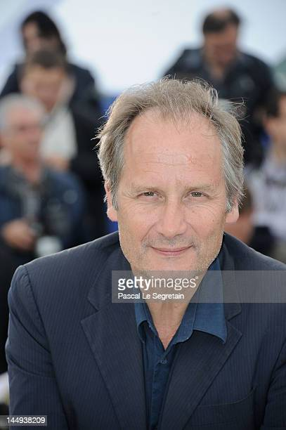 Actor Hippolyte Girardot poses at 'Vous N'avez Encore Rien Vu' Photocall during the 65th Annual Cannes Film Festival at Palais des Festivals on May...