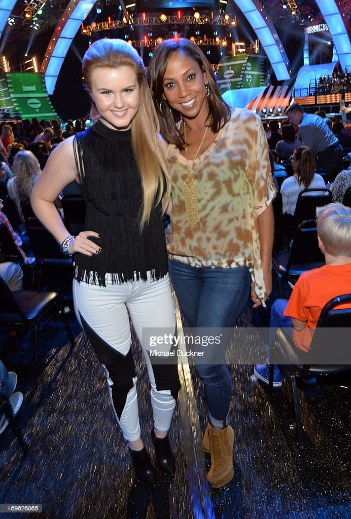 Actor Holly Robinson Peete (R) and recording artist Ashlee Keating attend Cartoon Network's fourth annual Hall of Game Awards at Barker Hangar on February 15, 2014 in Santa Monica, California.