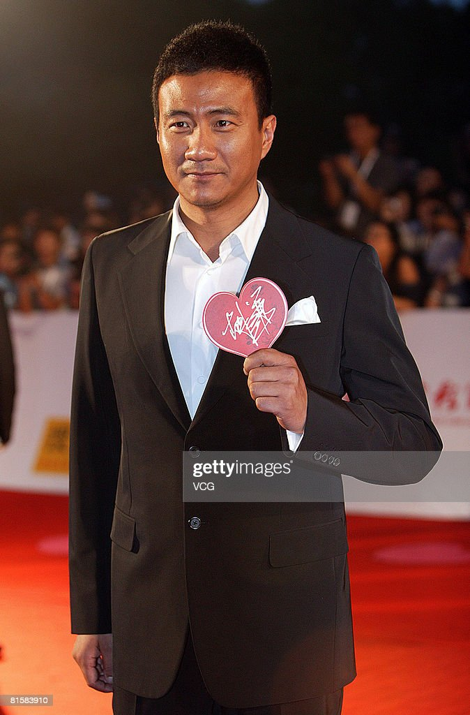 Actor Hu Jun arrives at the opening ceremony of the 11th Shanghai Film Festival on June 14, 2008 in Shanghai, China.