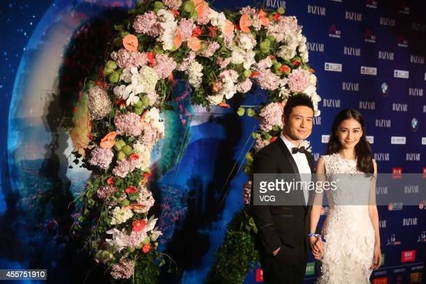 Actor Huang Xiaoming and actress Angelababy attend 2014 Bazaar Charity Night at China World Trade Center Tower III on September 19 2014 in Beijing...