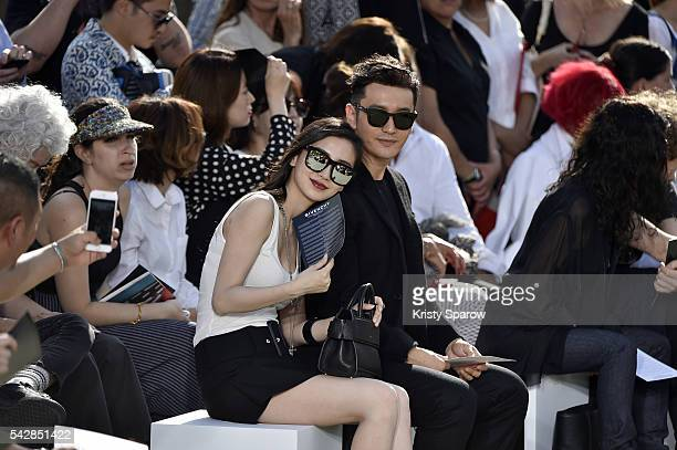 Actor Huang Xiaoming and his wife Angelababy attend the Givenchy Menswear Spring/Summer 2017 show as part of Paris Fashion Week on June 24 2016 in...