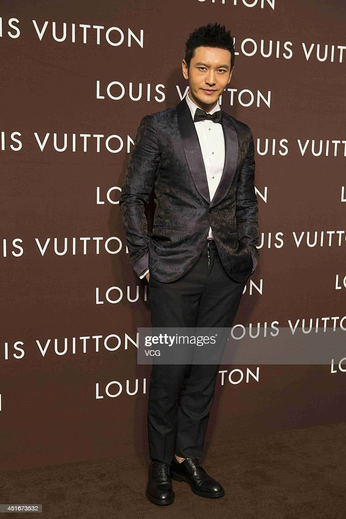 Actor <a gi-track='captionPersonalityLinkClicked' href=/galleries/search?phrase=Huang+Xiaoming&family=editorial&specificpeople=2136627 ng-click='$event.stopPropagation()'>Huang Xiaoming</a> attends Louis Vuitton flagship store opening ceremony at Chengdu IFS on July 3, 2014 in Chengdu, China.