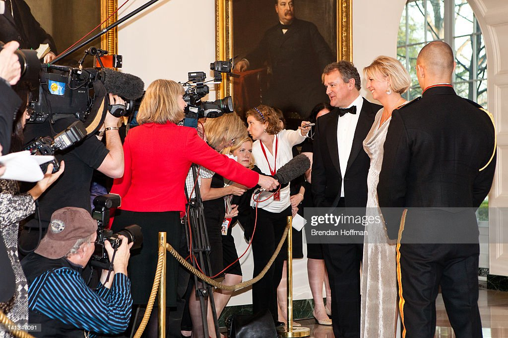 Actor <a gi-track='captionPersonalityLinkClicked' href=/galleries/search?phrase=Hugh+Bonneville&family=editorial&specificpeople=228840 ng-click='$event.stopPropagation()'>Hugh Bonneville</a> and LuLu Williams arrive for a State Dinner in honor of British Prime Minister David Cameron at the White House on March 14, 2012 in Washington, DC. Cameron is on a three day official visit to Washington.