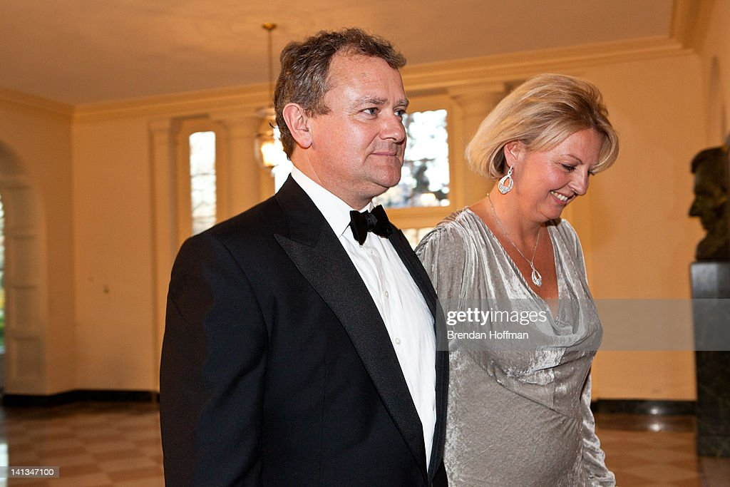 Actor <a gi-track='captionPersonalityLinkClicked' href=/galleries/search?phrase=Hugh+Bonneville&family=editorial&specificpeople=228840 ng-click='$event.stopPropagation()'>Hugh Bonneville</a> and LuLu Williams arrive for a State Dinner in honor of British Prime Minister <a gi-track='captionPersonalityLinkClicked' href=/galleries/search?phrase=David+Cameron+-+Politician&family=editorial&specificpeople=227076 ng-click='$event.stopPropagation()'>David Cameron</a> at the White House on March 14, 2012 in Washington, DC. Cameron is on a three day official visit to Washington.