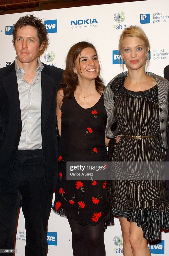 Actor Hugh Grant, actress Lucia Moniz and actress Heike Makatsch attend the premiere of their new movie 'Love Actually' at Palacio de la Musica Cinema October 27, 2003 in Madrid.