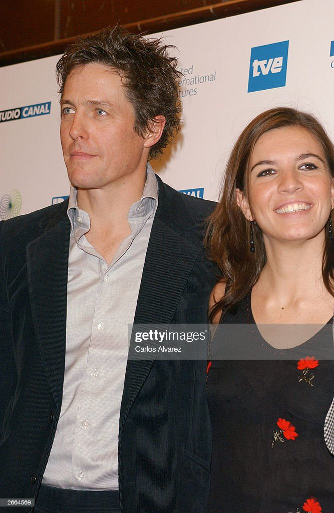 Actor Hugh Grant and actress Lucia Moniz attend the premiere of their new movie 'Love Actually' at Palacio de la Musica Cinema October 27, 2003 in Madrid.
