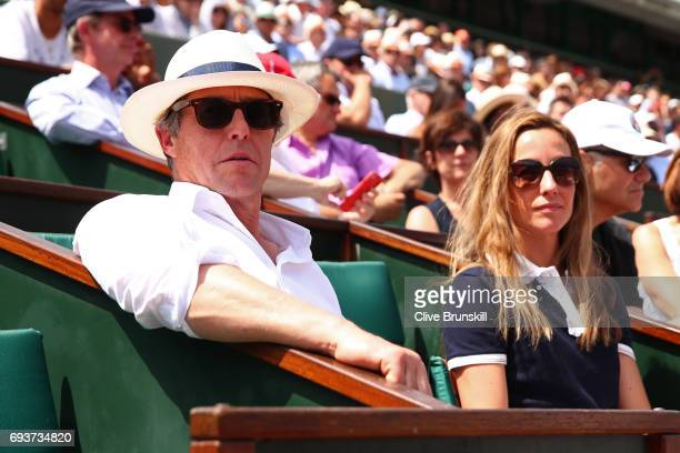 Actor Hugh Grant and Anna Eberstein watch the ladies semi final match between Jelena Ostapenko of Latvia and Timea Bacsinszky of Switzerland on day...