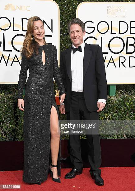 Actor Hugh Grant and producer Anna Elisabet Eberstein attend the 74th Annual Golden Globe Awards at The Beverly Hilton Hotel on January 8 2017 in...