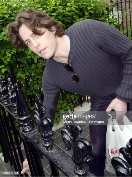 Actor Hugh Grant leaves his London home refusing to answer reporters' questions on his split with model and actress Elizabeth Hurley His only comment...