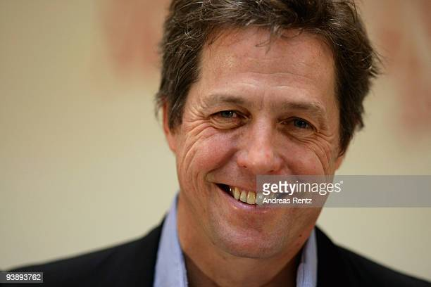 Actor Hugh Grant poses at the photocall to promote his new film 'Did You Hear About the Morgans' at Hotel de Rome on December 4 2009 in Berlin Germany