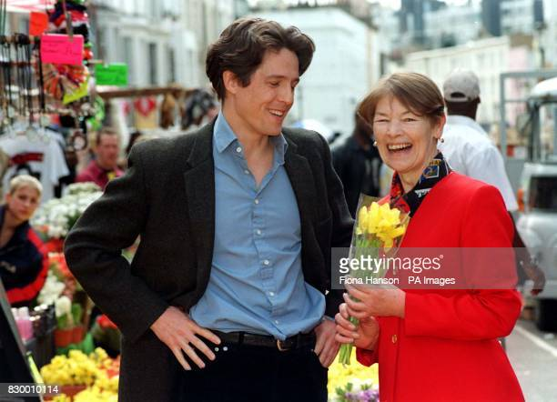 Actor Hugh Grant presents former actress Glenda Jackson now Minister of Transport for London during a visit to the set of his latest film on location...