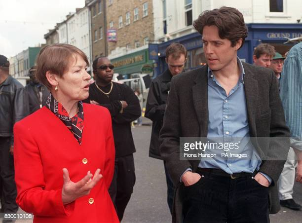 Actor Hugh Grant talks with actress turned London Transport minister Glenda Jackson during her visit to the set of his latest film in Notting Hill...