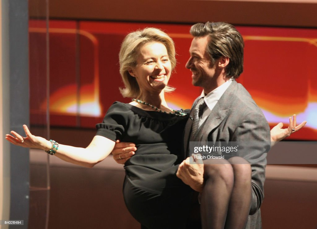 Actor Hugh Jackman carries German Family Minister Ursula von der Leyen during the livebroadcast of German TV show 'Wetten dass' at the Messe...