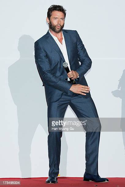 Actor Hugh Jackman dances to a song by South Korean rapper Psy 'The Wolverine' South Korea Premiere at COEX Mega Box on July 15 2013 in Seoul South...