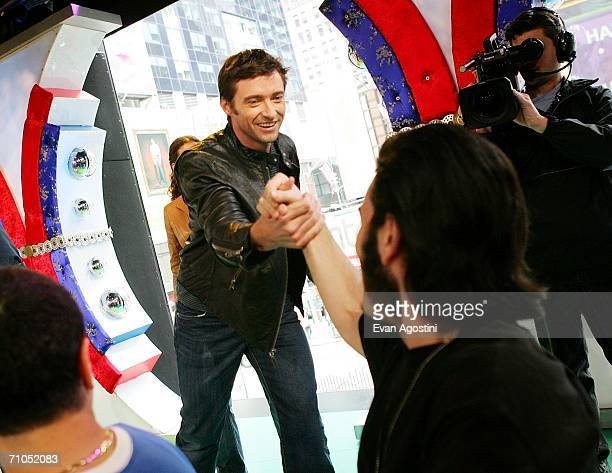 Actor Hugh Jackman greets Wolverine and XMen fan Keith Grillman from Howard Beach NY during an appearance on MTV's Total Request Live to promote the...