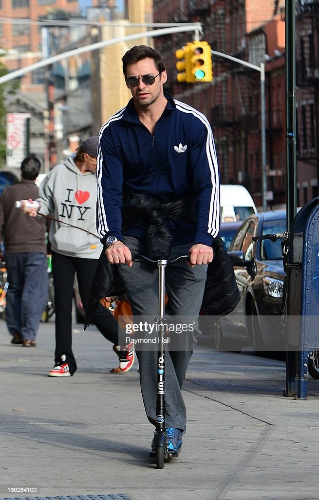 Actor <a gi-track='captionPersonalityLinkClicked' href=/galleries/search?phrase=Hugh+Jackman&family=editorial&specificpeople=202499 ng-click='$event.stopPropagation()'>Hugh Jackman</a> is seen on is scooter in Soho on October 29, 2013 in New York City.