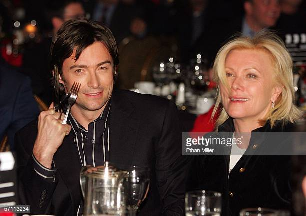 Actor Hugh Jackman jokes about his Wolverine character in the audience with his wife DeborraLee Furness during the final banquet and awards ceremony...
