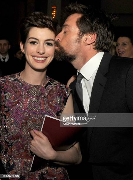 Actor Hugh Jackman kisses actress Anne Hathaway during the 65th Annual Directors Guild Of America Awards at Ray Dolby Ballroom at Hollywood Highland...