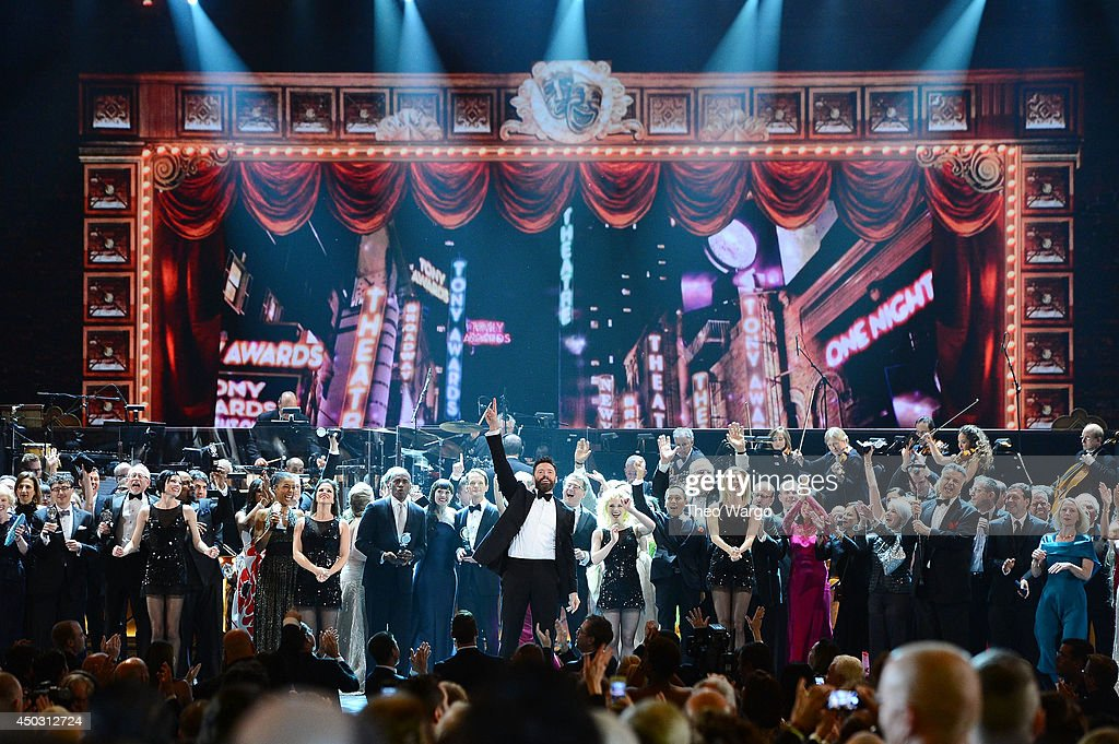 Actor <a gi-track='captionPersonalityLinkClicked' href=/galleries/search?phrase=Hugh+Jackman&family=editorial&specificpeople=202499 ng-click='$event.stopPropagation()'>Hugh Jackman</a> (C) onstage during the 68th Annual Tony Awards at Radio City Music Hall on June 8, 2014 in New York City.