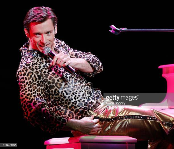 Actor Hugh Jackman performs at the media call for 'The Boy From Oz' a musical based on the life of 1970's singersongwriter Peter Allen at the Rod...